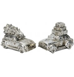 A mix of distressed silver ornamental car decorations,