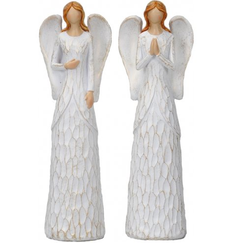 Elegant carved angel figures in assorted poses. Each with gold tipped wings and a shabby chic finish.