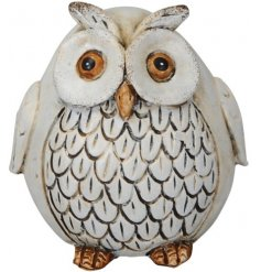 A shabby chic style resin owl ornament with textured feathers. A chic decorative item for the home and garden.