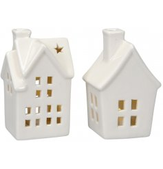 An assortment of 2 LED filled white ceramic houses