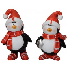 A cute mix of festive themed resin penguins dressed up in red hats and scarves