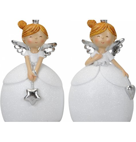 Sweet angel figurines wearing sparkling glitter dresses complete with silver bows, crowns and angel wings.