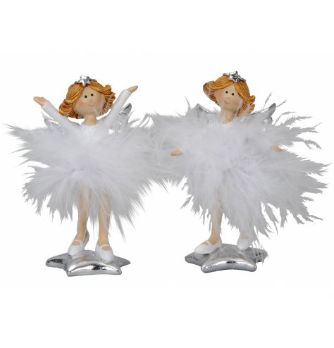 Magical angel figurines in fluffy feather skirts and star tiaras stood upon shining silver stars.