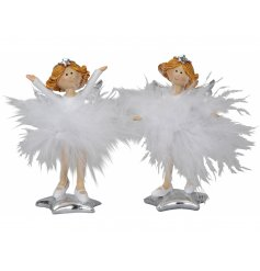 A mix of standing resin angel figures dressed up white snowball inspired feather skirts