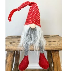 A dangly legged fabric gonk set with a long fuzzy grey beard, round button nose and high pointed knitted hat
