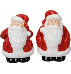 A mix of 2 jolly little sitting Santa figures, dressed up in festive red tones