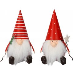 An assortment of 2 metal sitting gonk decorations with large faux fur beards, pointed patterned hats and tree/star wand