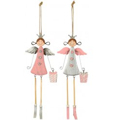 A cute mix of hanging wooden angel decorations in pink and silver tones
