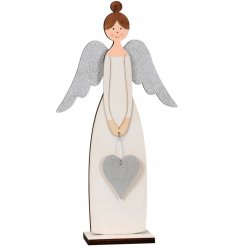 A shabby chic style wooden angel with silver glitter wings and a silver glitter heart. A chic seasonal ornament.