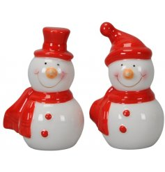 An assortment of small ceramic snowmen with carrot noses, rosey cheeks and festive red scarves