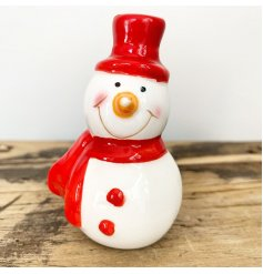 A cute mix of mini ceramic snowmen figures, dressed up in festive red toned hats and scarves