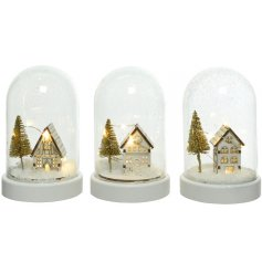 A charming mix of small LED Scenes inside glass cloches