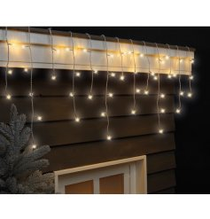 Bring a soft twinkle to any home interior or exterior with this beautiful string of dangling lights