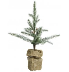 Add a frosty feel to any table centre or home display at Christmas Time with this charming artificial Pine Tree with add