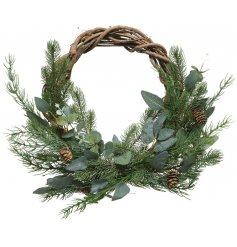 A beautifully decorated round wreath with an entwined twig decal and added woodland foliage finish