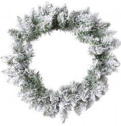 A Charmingly simple round bushy wreath with an added snowy finish