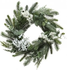 A large decorative wreath built up with assorted foliage and plants