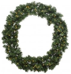 A Pre-Lit Round Imperial Wreath with a warm white glow.