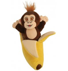 A plush monkey soft toy with a matching banana enclosure