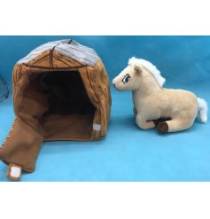 A plush pony soft toy with a matching stable enclosure