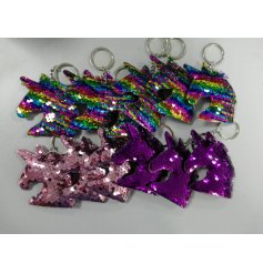 An assortment of funky sequin covered keyrings in a unicorn head form