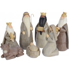 A traditional inspired Nativity Scene featuring Mary, Joseph, The Three Kings, a Cow and Baby Jesus