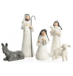 A charming traditional set of Nativity Scene Pieces in a wood carving inspired finish