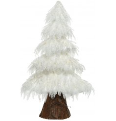 Bring a frosted feel to any themed home or display with this foam based tree with added fur and glitter accents