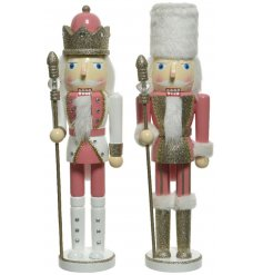 An assortment of firwood nutcrackers with an added glitz twist and pink charm