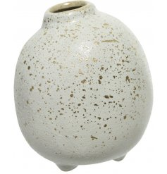 A large round stoneware vase with a whitewashed base and added gold splash effect