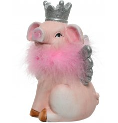 A fabulous little piggy bank with an added fluffy feather boa and crown