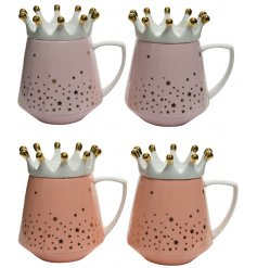 An assortment of Porcelain Mugs in pretty pink tones, topped with crown lids and an added gold star decal