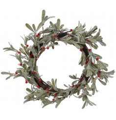 A beautifully simple round wreath with added frosted leaves and red berries