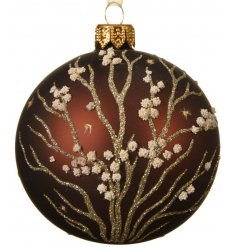 A beautifully detailed glass bauble with gold glitter branches and dotted flowers