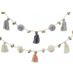 An assortment of Pink and Grey toned string garlands with added bells, pompoms and tassels