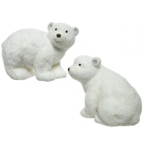 An assortment of 2 cute polar bear decorations in sitting and standing poses.