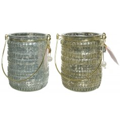 A stylish mix of glass candle holders in assorted blue and green tones. Each featuring a ridge effect and added pearl d