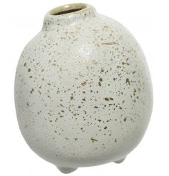A round stoneware vase with a whitewashed base and added gold splash effect