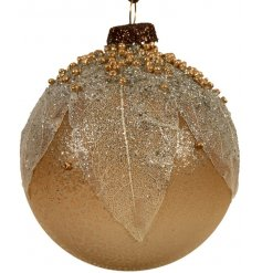 A beautifully ornate glass bauble with real leaves. Each is decorated with an abundance of brown, gold and silver beads.