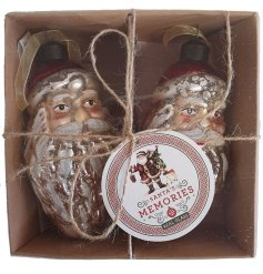 A hanging glass Santa head complete with a mottled effect and added distressed charm