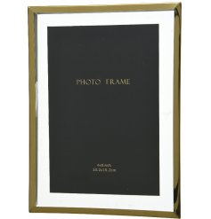 A chic and contemporary inspired glass picture frame featuring a rustic gold toned edging