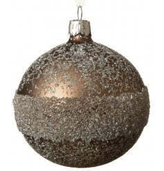 A rough luxe style glass bauble in a gorgeous cashmere brown colour. The matt surface is decorated with a beaded band