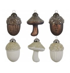 A mix of woodland inspired glass decorations including acorn and mushroom designs