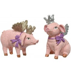 An assortment of 2 pink pig ornaments with purple bows and gold glitter crowns and wings.