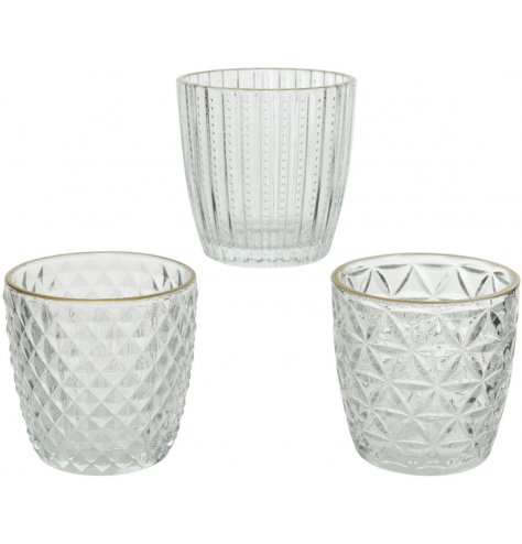 Vintage inspired cut glass votives in an assortment of three designs. Each is complete with a delicate gold rim.