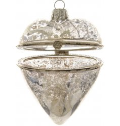 A hanging glass trinket heart featuring a distressed decal and floral clasp