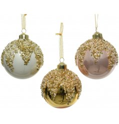 A mix of pink, gold and white glass baubles each with an ornate beaded top.