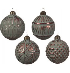 An assortment of four luxury glass baubles, each with a pine green wash