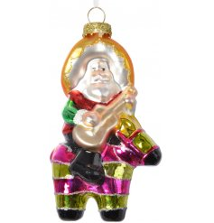 Bring a little sunshine into your home this season with this original glass decoration featuring Santa on a pinata horse