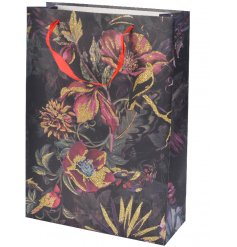 Set with a dark based tone, this beautifully illustrated gift bag also features a delicate golden sparkle
